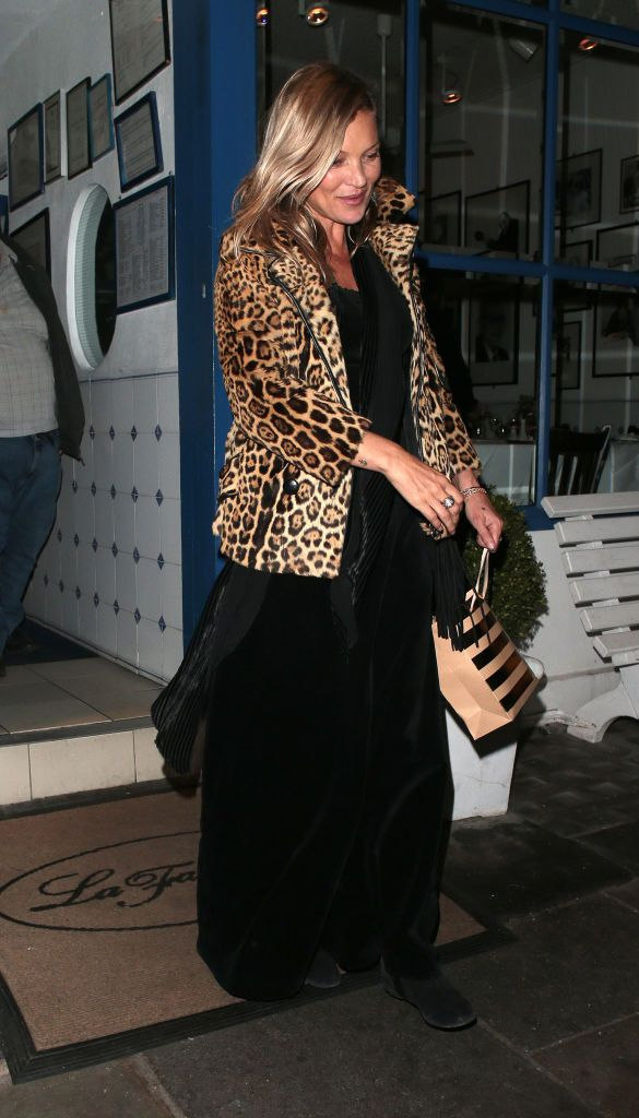 Kate Moss wearing her iconic leopard coat.