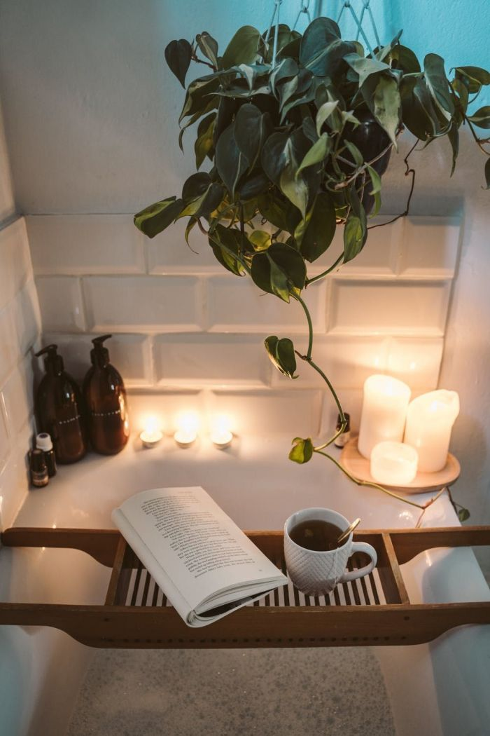 A bath with candles, tea and a book