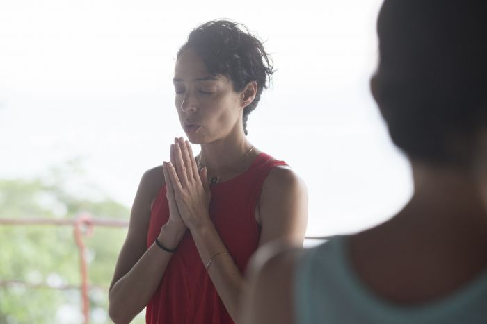 A woman practices her breathing to reduce stress