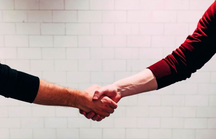 Two people shaking hands after meeting each other for the first time