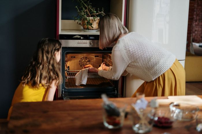 A mother and daughter cooking together, spending more time with each other during weeknights.
