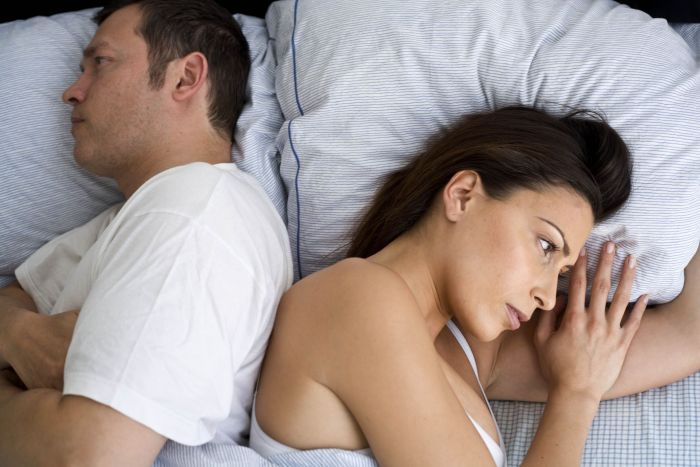 Woman upset because her partner doesn't read how she's feeling.