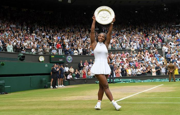 Serena Williams with the winners trophy after defeating Angelique Kerber in the women's final of the Wimbledon Tennis Championships