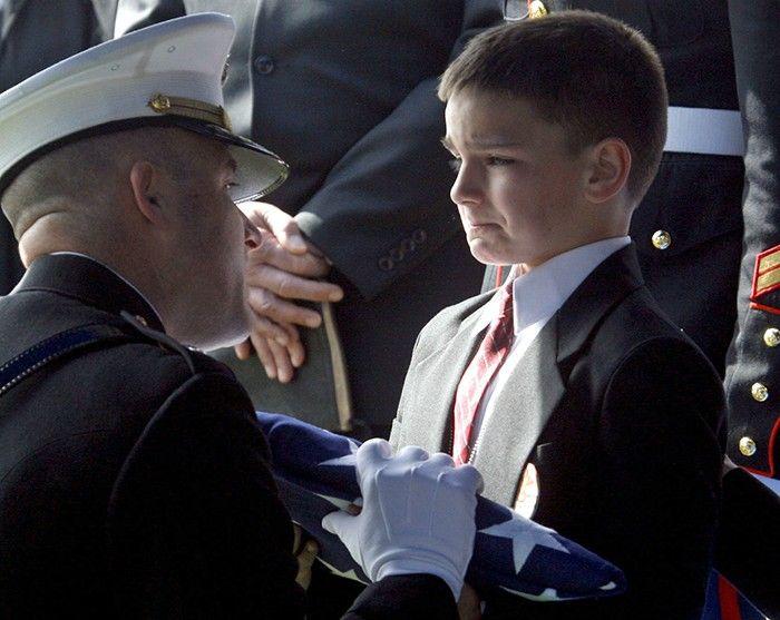 man facing little boy