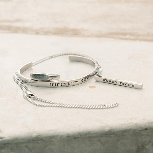 bracelets with custom coordinated engraved on them