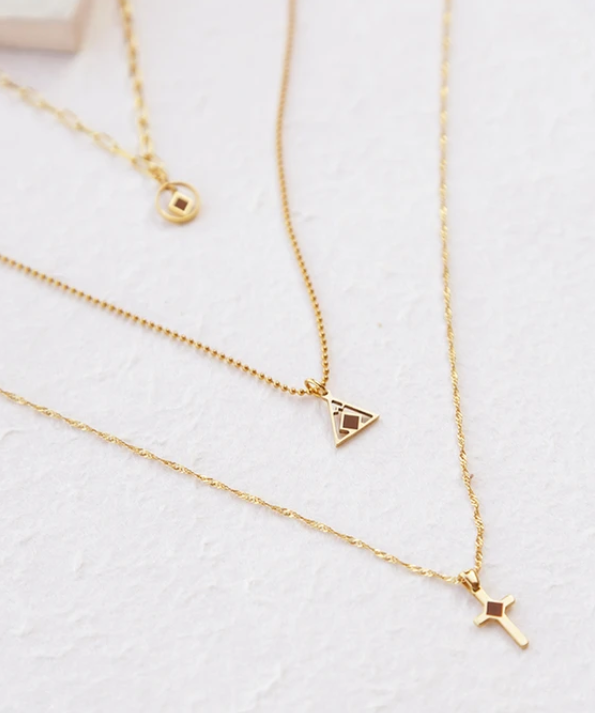 Three gold necklaces by Divine Supervision